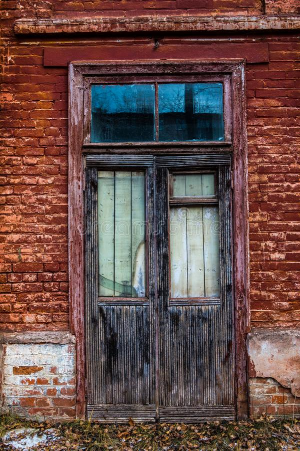 Old wooden window in an old brick wall. Old wooden window. Old brick wall. Grunge background stock photos