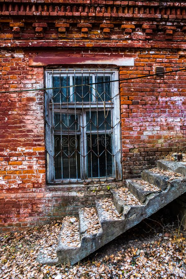 Old wooden window in an old brick wall. Old wooden window. Old brick wall. Grunge background royalty free stock photos