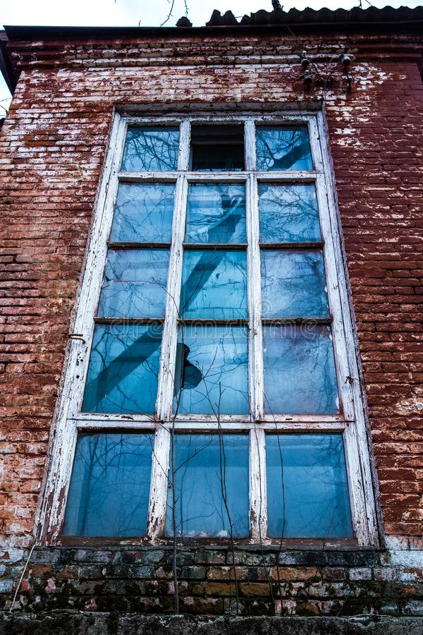 Old wooden window in an old brick wall. Old wooden window. Old brick wall. Grunge background royalty free stock images