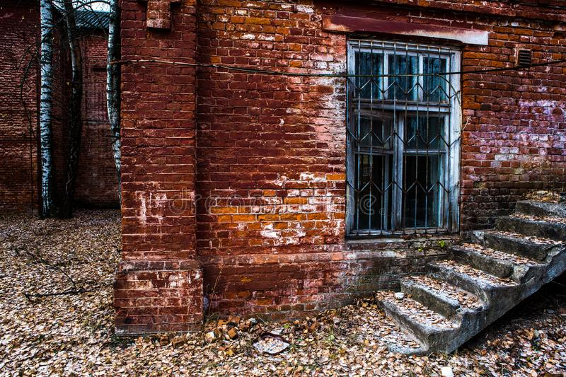 Old wooden window in an old brick wall. Old wooden window. Old brick wall. Grunge background royalty free stock photography