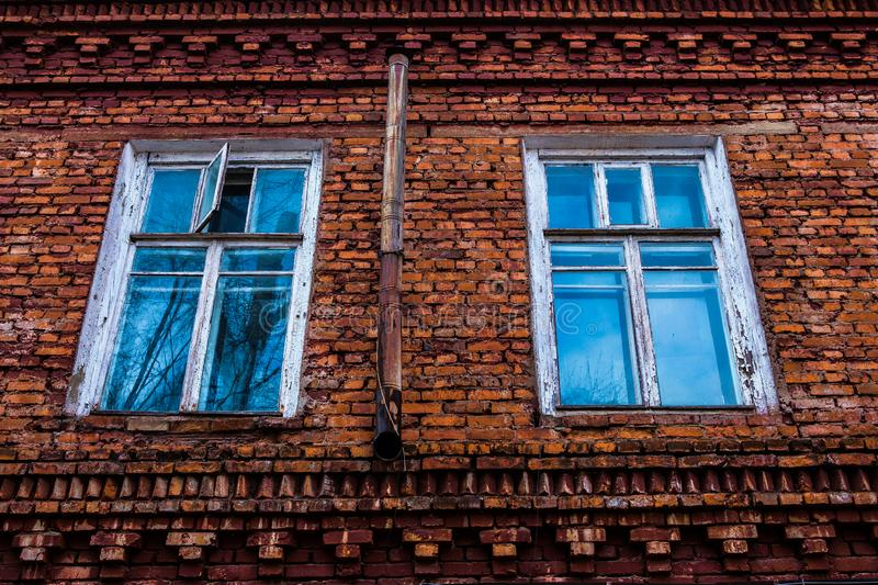 Old wooden window in an old brick wall. Old wooden window. Old brick wall. Grunge background stock image