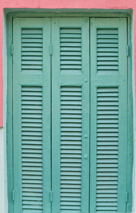 Old wooden window with shutters stock images