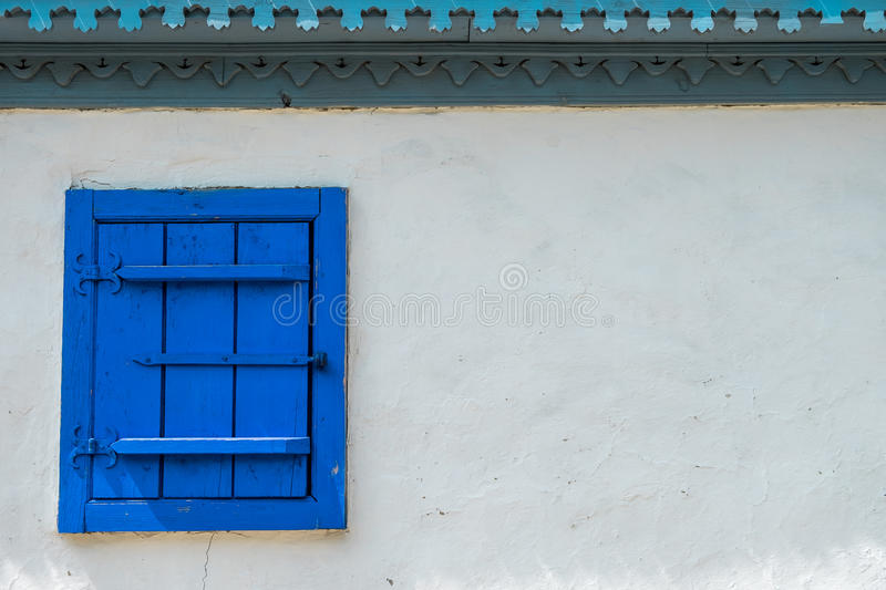 Old wooden window on white wall royalty free stock image