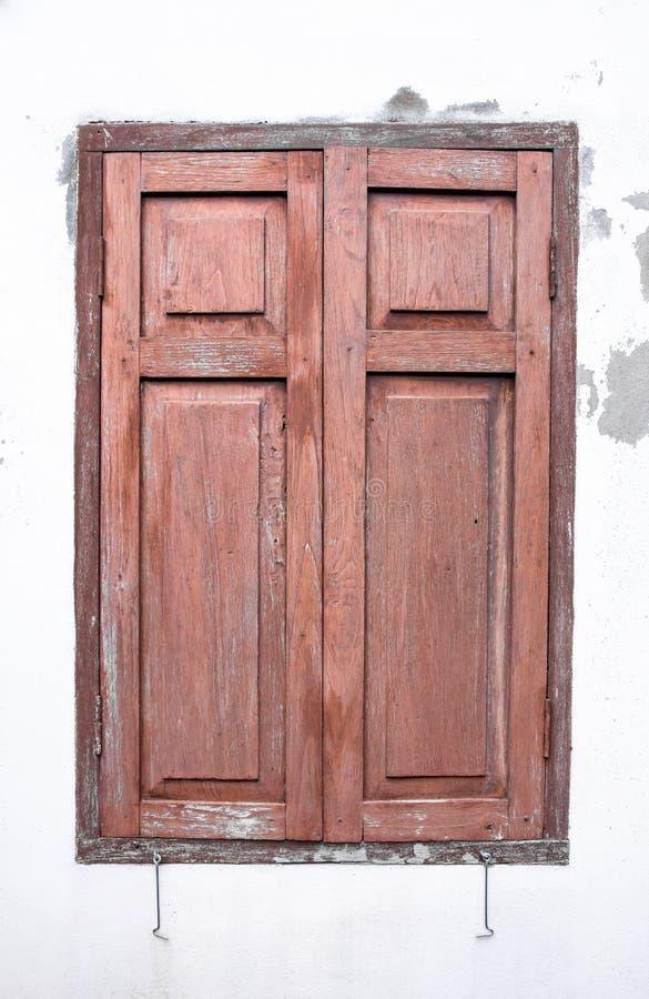 Old wooden windows on concrete white wall. Background stock photos