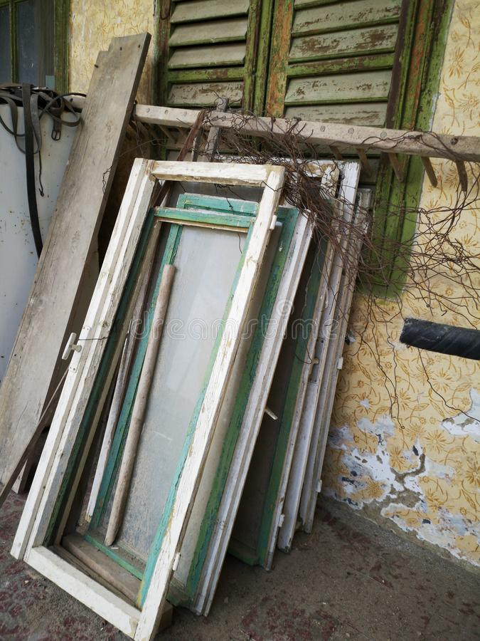 Old wooden windows. Dismantled the old wooden windows in abandoned house stock images