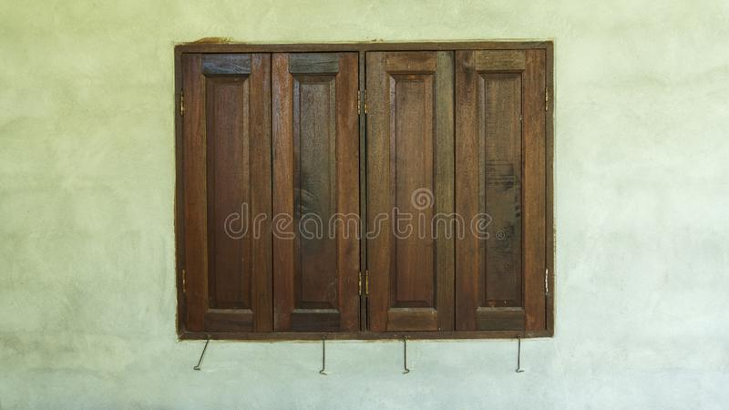 Old wooden windows frame on cement wall stock photos