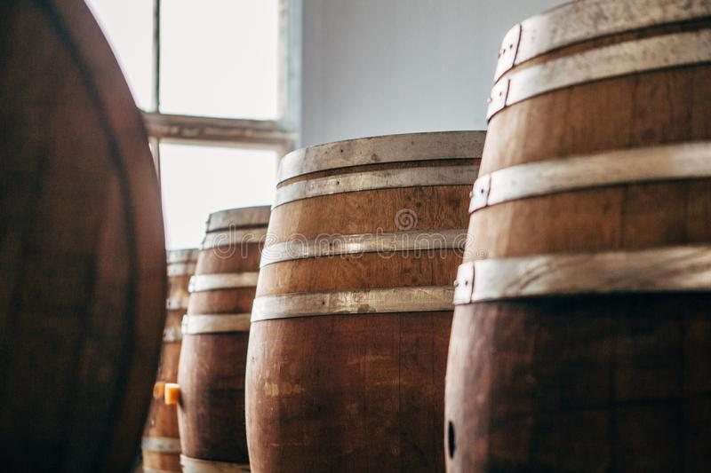 Old wooden wine barrels with iron hoops in stock. royalty free stock images
