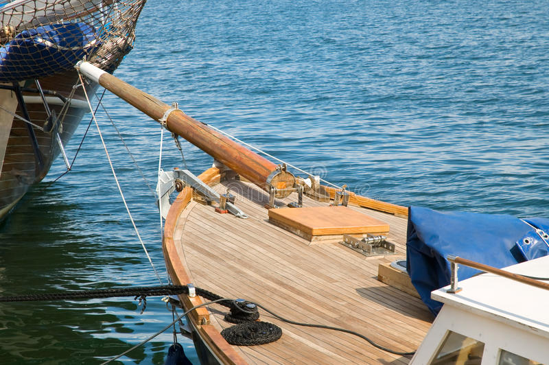 Old wooden yacht. Old wooden tall yacht docked in a sea port royalty free stock image