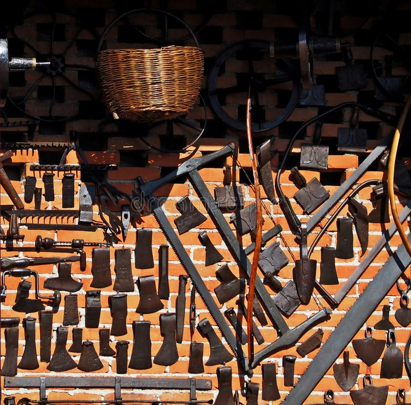 Free Old Woodworking Tools And Agricultural Tools Hung On A Brick Wall Stock Photo - 114192340