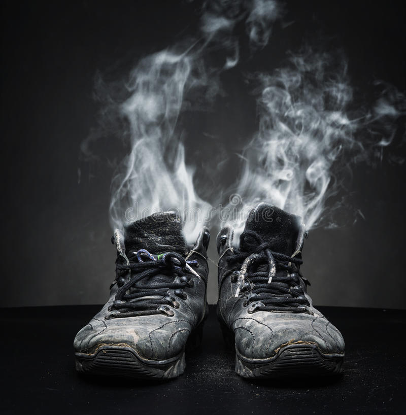 Old work shoes in smoke royalty free stock photos