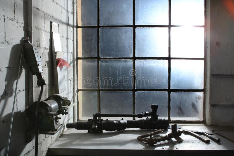 Old work space with dirty dusty windows and tools royalty free stock photography