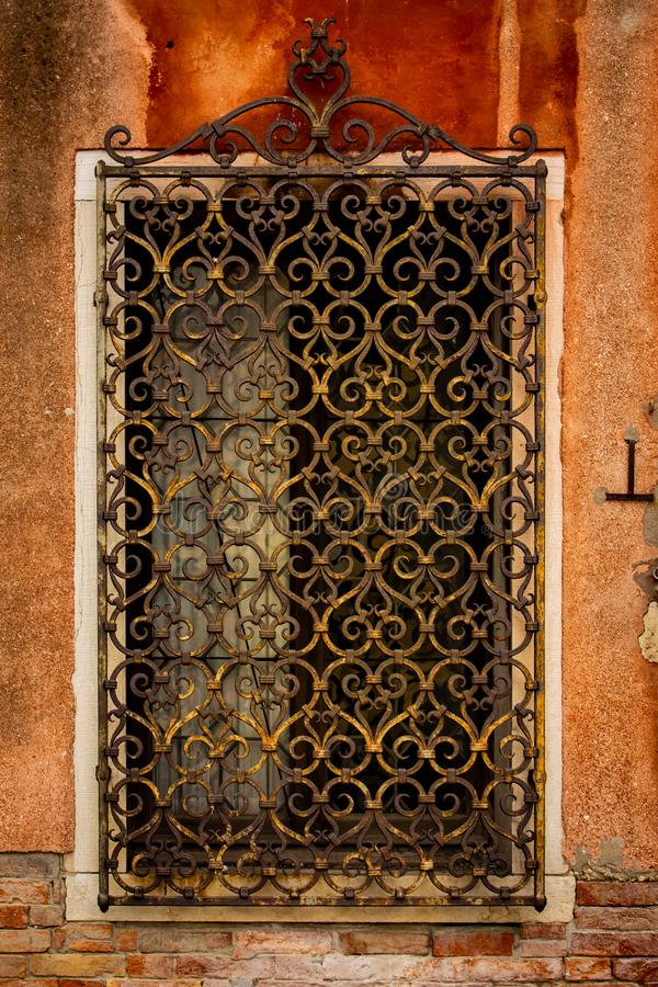 Old and worked metal grate made by hand. stock photos