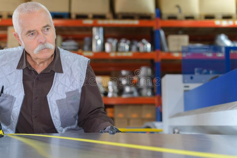 Old worker concentrated on task royalty free stock images