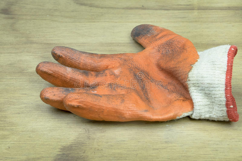 Old working gloves. Over wooden table, construction tools royalty free stock photos