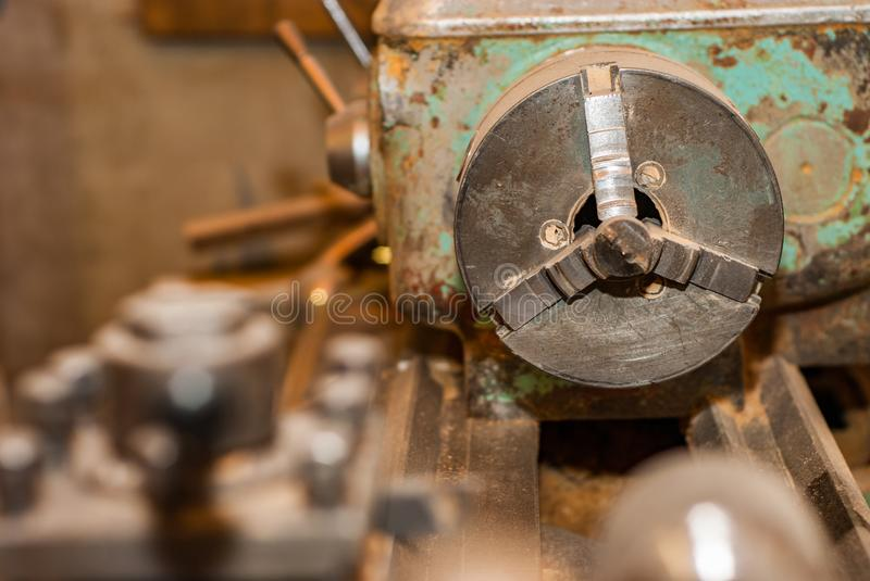 Old working lathe in production. Old working lathe in the shop royalty free stock photography