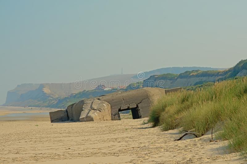 Old world war II bunker on the beach of the French opal coast stock photography