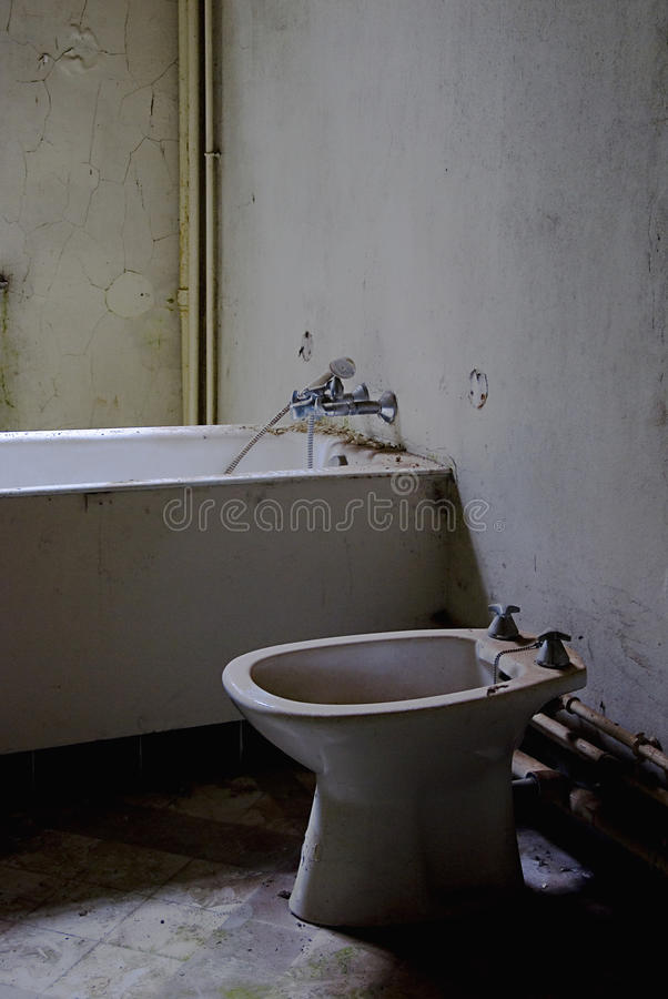 Old worn bathroom stock image