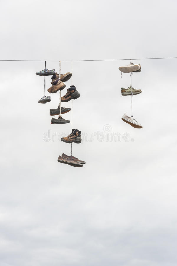 Old Worn Boots Or Shoes Hang On A Cable Stock Photo - Image of worn ...