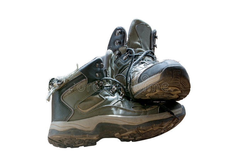 Old worn hiking boots isolated on white background royalty free stock photography