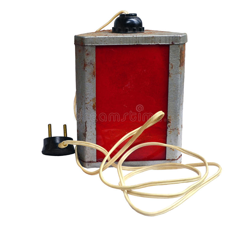 Old worn laboratory red lamp. On a white background, with spots of developer and a fixer, corrosion on the case, and the plastic wire which turned yellow from stock images