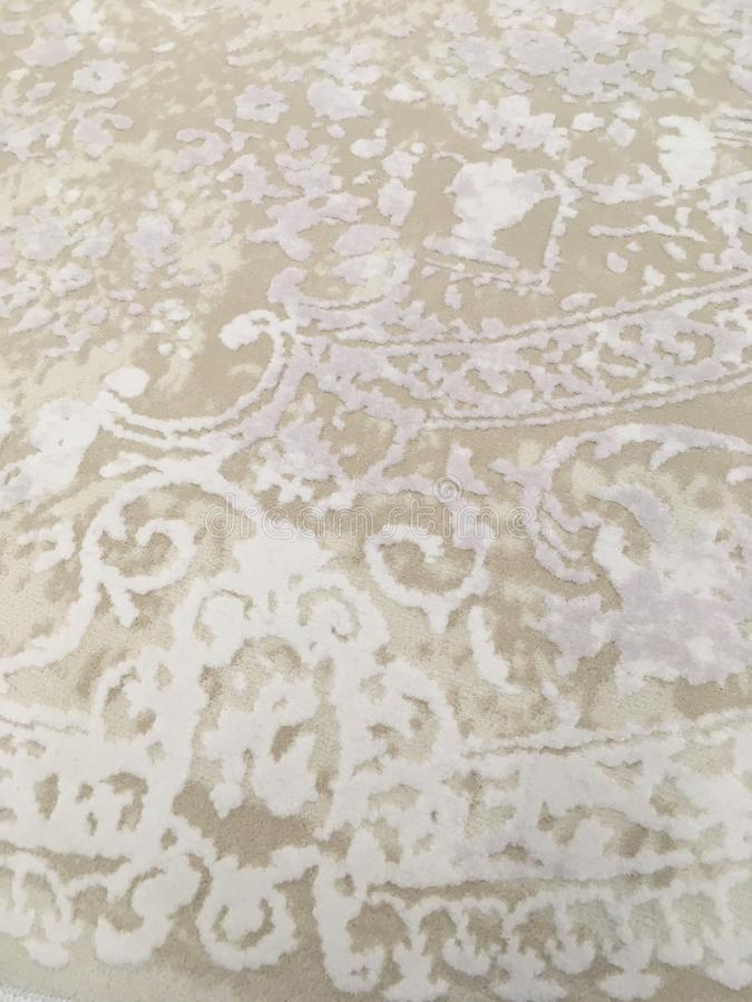 Old worn out elegant damask pattern carpet / floor covering. Luxury grunge vertical background stock photo