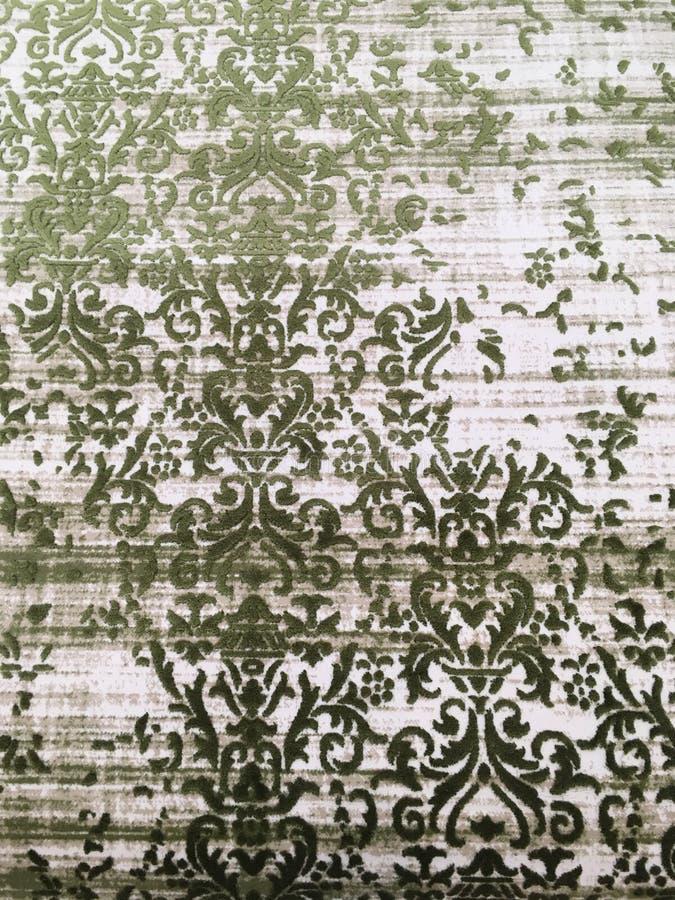 Old worn out elegant damask pattern carpet / floor covering. Luxury grunge vertical background royalty free stock image