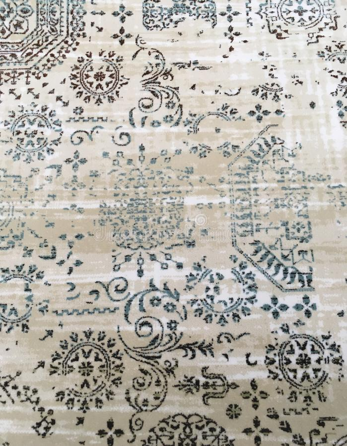 Old worn out elegant damask pattern carpet / floor covering. Luxury grunge vertical background royalty free stock photography