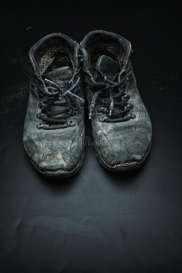 Old worn out shoes stock photography