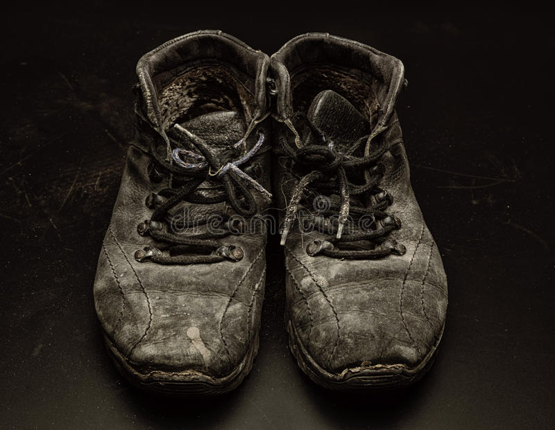 Old worn out shoes royalty free stock images
