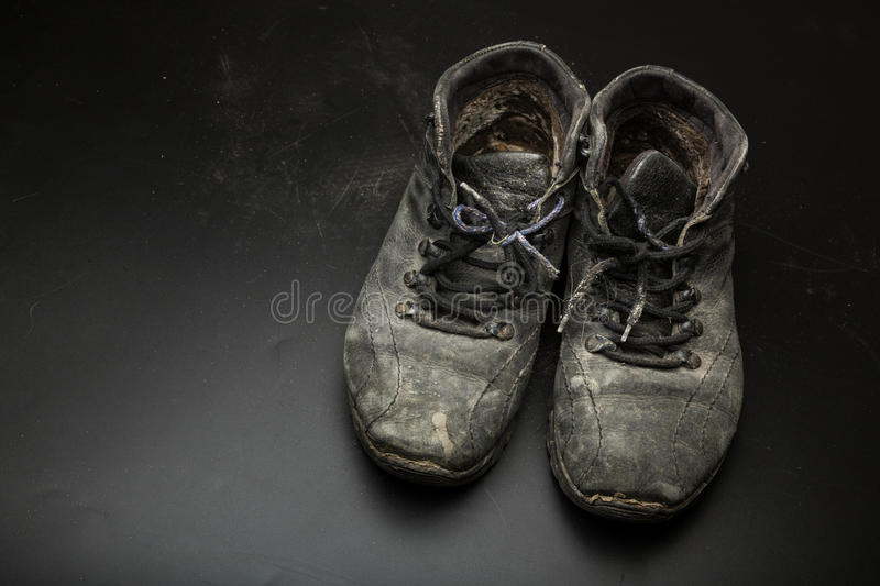 Old worn out shoes. On the floor stock photos