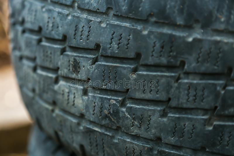 Old worn-out summer tires royalty free stock photo