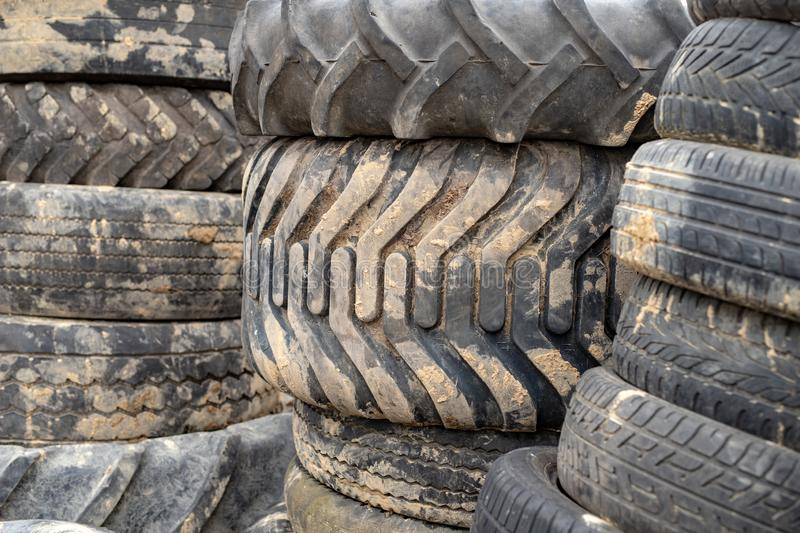 Old worn out tires on an abandoned trash dump. Garbage heap ready for disposal. Season of the spring royalty free stock photos
