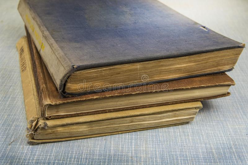 Old worn out vintage books on the table stock photo