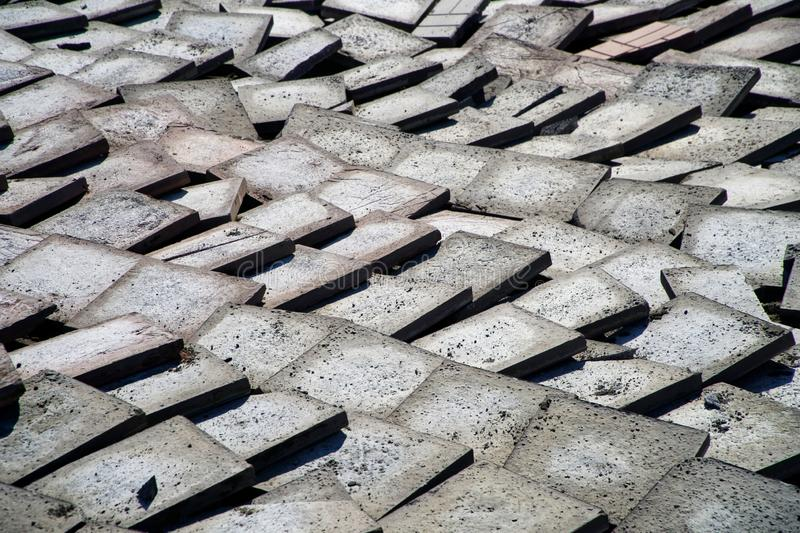 Old worn pavement tile after dismantling during reconstruction. Urban economy royalty free stock photos