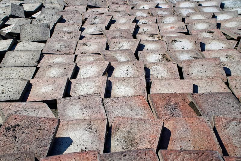 Old worn pavement tiles after dismantling from the streets of the city. Urban economy. Chip royalty free stock image
