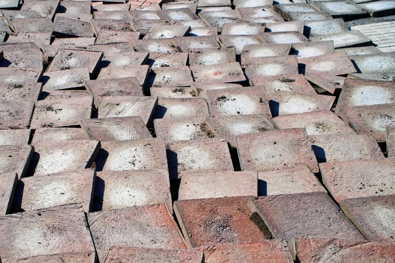 Old worn paving slabs during dismantling from a city street. Reconstruction. Urban economy royalty free stock photo