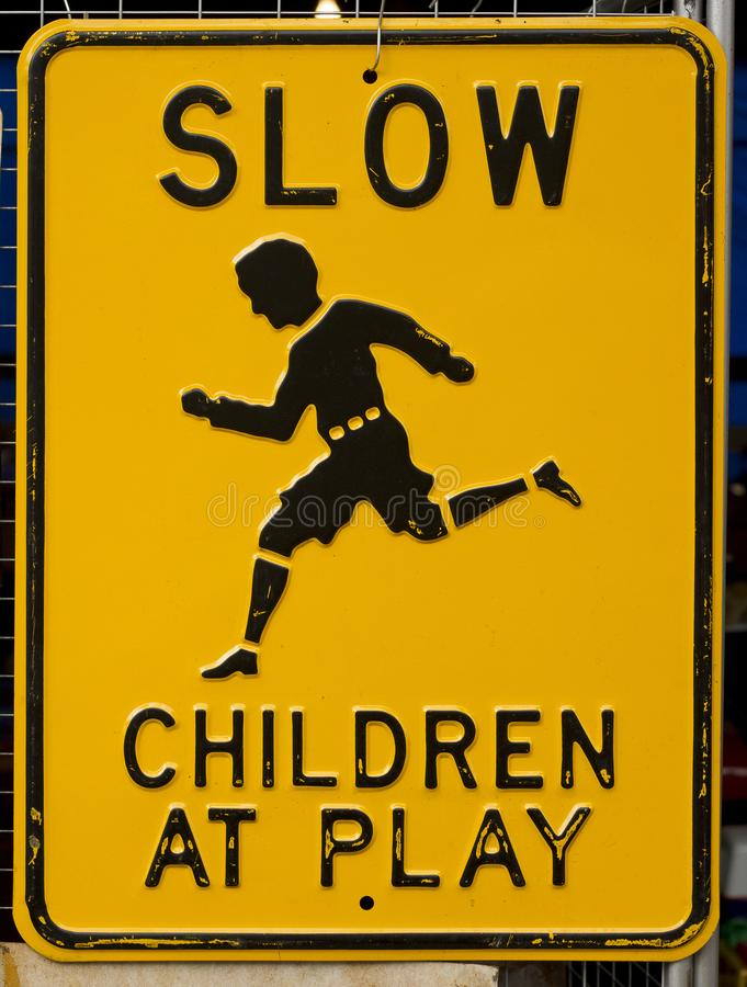 Worn Slow Children At Play Sign stock photo