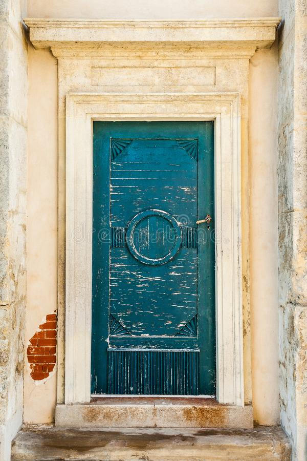 An old worn rustic green door royalty free stock photography