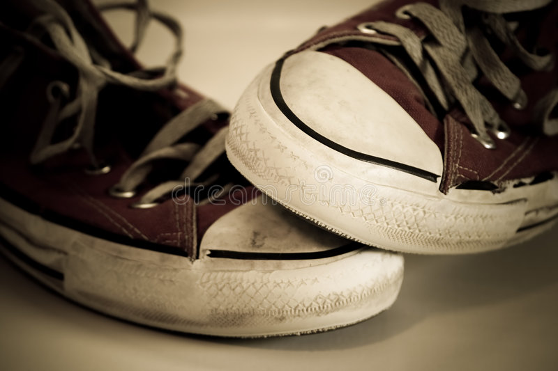 Old worn shoes. A shot of old worn shoes royalty free stock photo