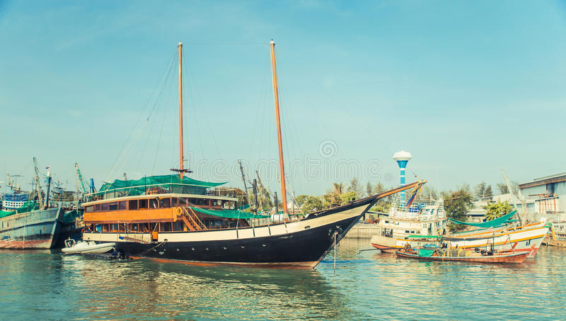 Old wreck Ship Harbor fishing and travel boat stranded. Thailand. stock images