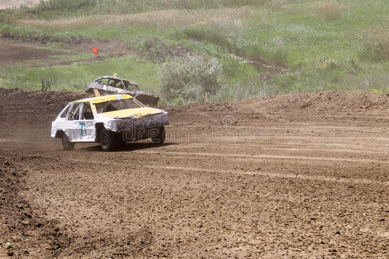 Old wrecked cars stock race. Racing in open air with dust royalty free stock images