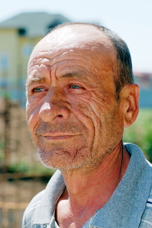 Old wrinkled man stock photos