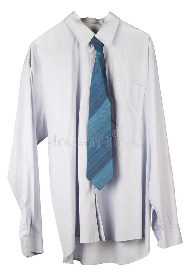 Old wrinkled washed-up man`s shirt and tie is hanging on a hange royalty free stock photo