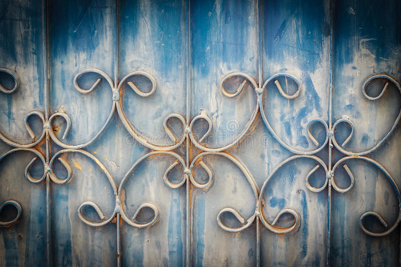 Old wrought iron bars on the gate with grunge and rusty steel b royalty free stock photos