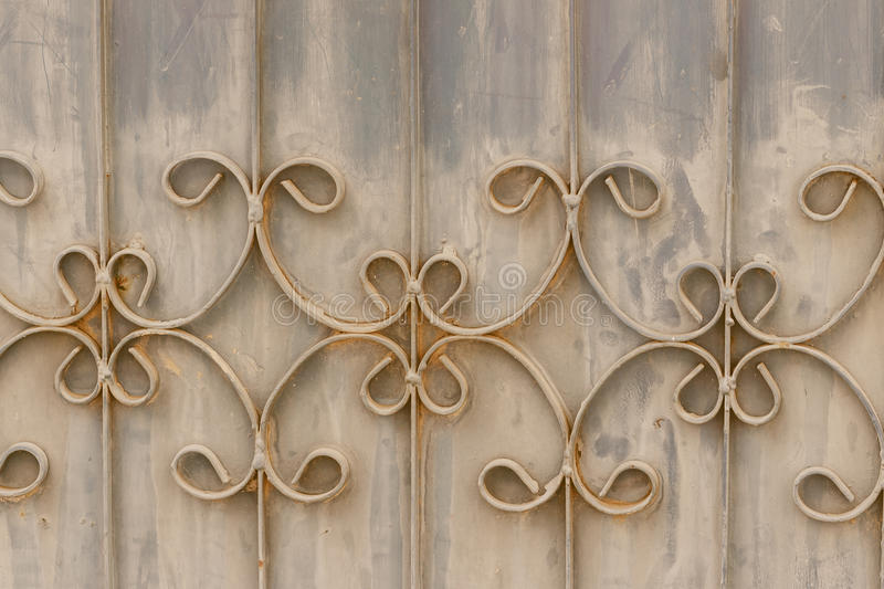 Old wrought iron bars on the gate with grunge and rusty steel b stock images