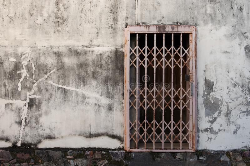 Old wrought iron doors on gray cement floor royalty free stock images