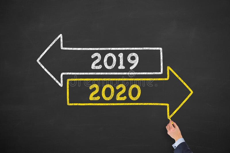 Old Year New Year 2020 on Blackboard Background royalty free stock photography