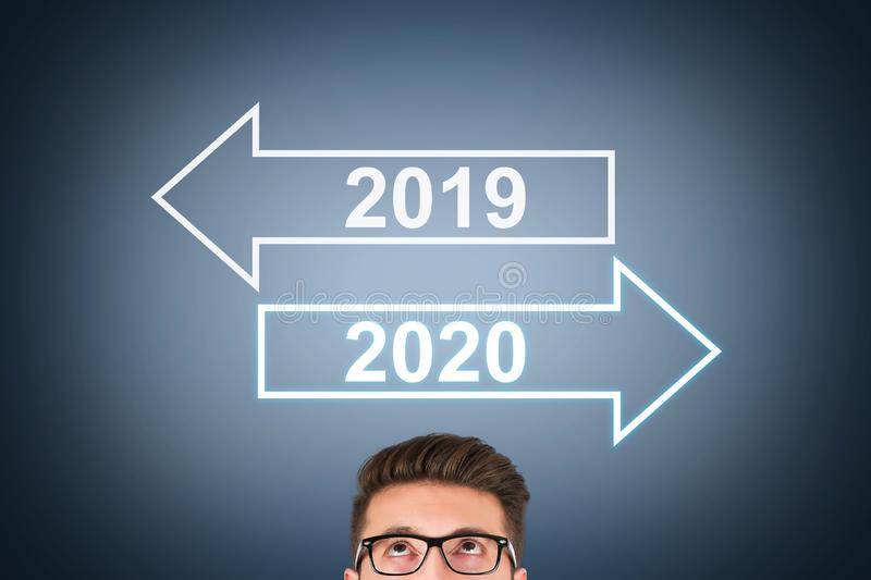 Old Year New Year 2020 over Human Head on Visual Screen stock image