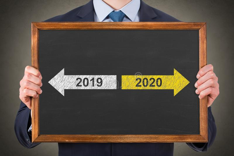 Old Year New Year 2020 on Chalkboard Background royalty free stock photos