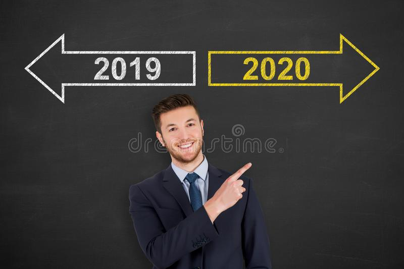 Old Year New Year 2020 over Human Head on Blackboard Background stock photography